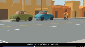 Campanha da Prefeitura de Vitória recomenda pedalar junto ao meio-fio e mostra ciclista desviando de carros parados sem olhar nem sinalizar. Imagem: Reprodução