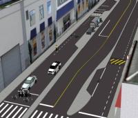 """As vias calmas também incluem as """"bicicaixas"""", entre a faixa de contenção dos carros e a faixa de pedestres, dando preferência aos ciclistas na abertura do sinal - no canto inferior esquerdo da imagem. (Crédito: reprodução PDC - IPPUC)"""