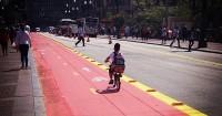 crianca indo para a escola de bicicleta fb h - Foto Aline Os