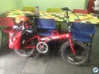 Bicicleta sendo recebida dentro de um comércio. Foto: Fabio Nazareth